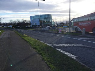 The main route continues where the bus is but the cycle lane takes you into the industrial estate on the left