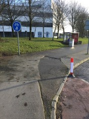 Cycle lane mounts footpath again and cuts through another bus stop/shelter