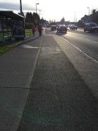 Another cycle lane cutting through a bus stop/shelter